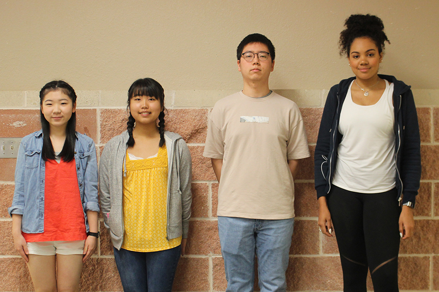 Foreign exchange students (from left to right) Riko Miyata, Mizuki Kita, Marie Anyiam, and Ricky Lee pose for a group photo.