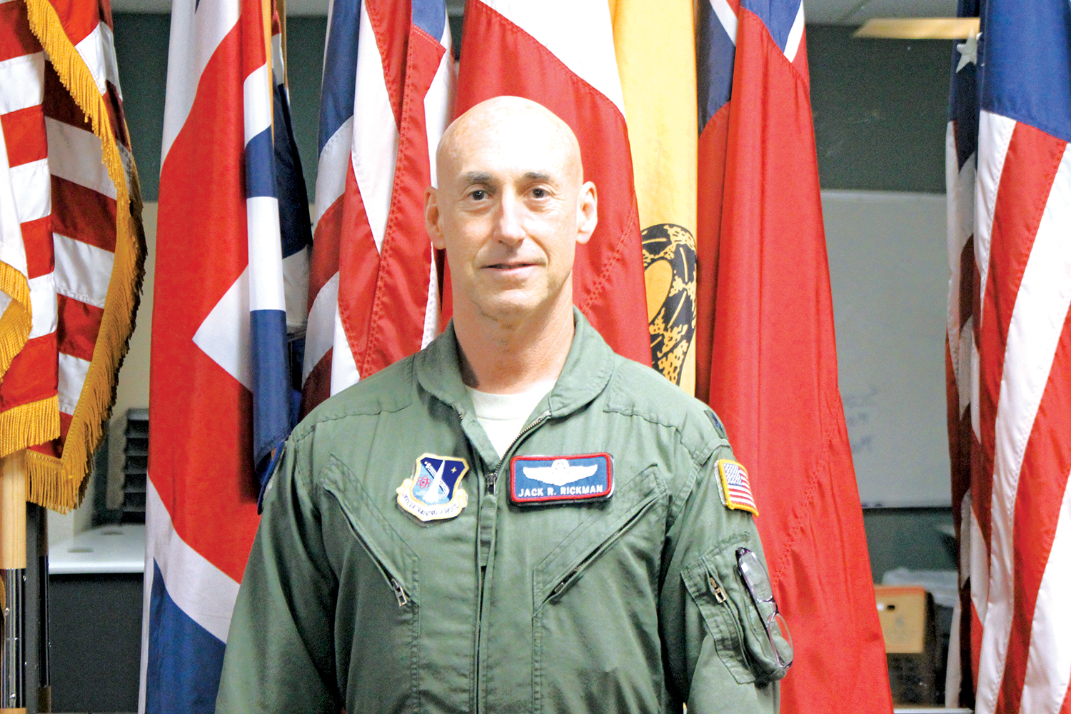 Colonel Jack R. Rickman, a command pilot with 3200 total  ying hours uses his experiences to help the AFJROTC program. Col. Rickman recounts his past missions, like having to land a C-5, a large military transport aircraft, with the nose gear retracted and a nearly empty fuel tank with 50 passengers on board.