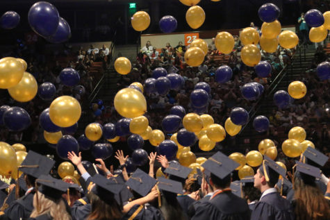 Graduates watch balloons drop on graduation day at Frank Erwin Center.
