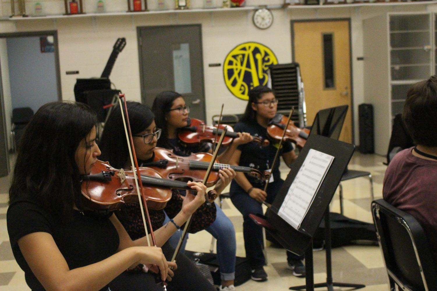 Students play violin as part of the Mariachi Club after school in the orchestra room. The club meets on Wednesdays starting at 4:30 p.m.