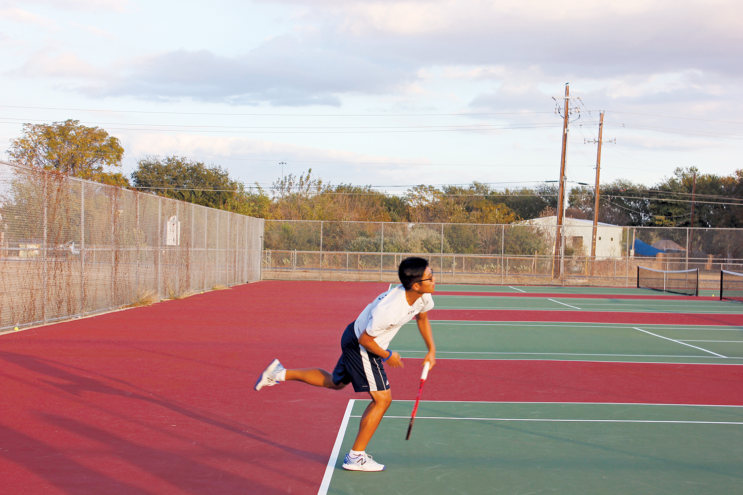 Practice Makes Perfect Senior Andy Doan practices his serve. Doan and the Akins Tennis team head into the spring season hoping to bounce back from a lackluster fall season