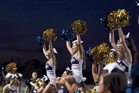 Junior Marrissa Almaraz (center) Cheer Captain and the rest of the cheer team energize the crowd at the Akins Homecoming game. The cheer program welcomed new Coach Jordyn Marsh this year.