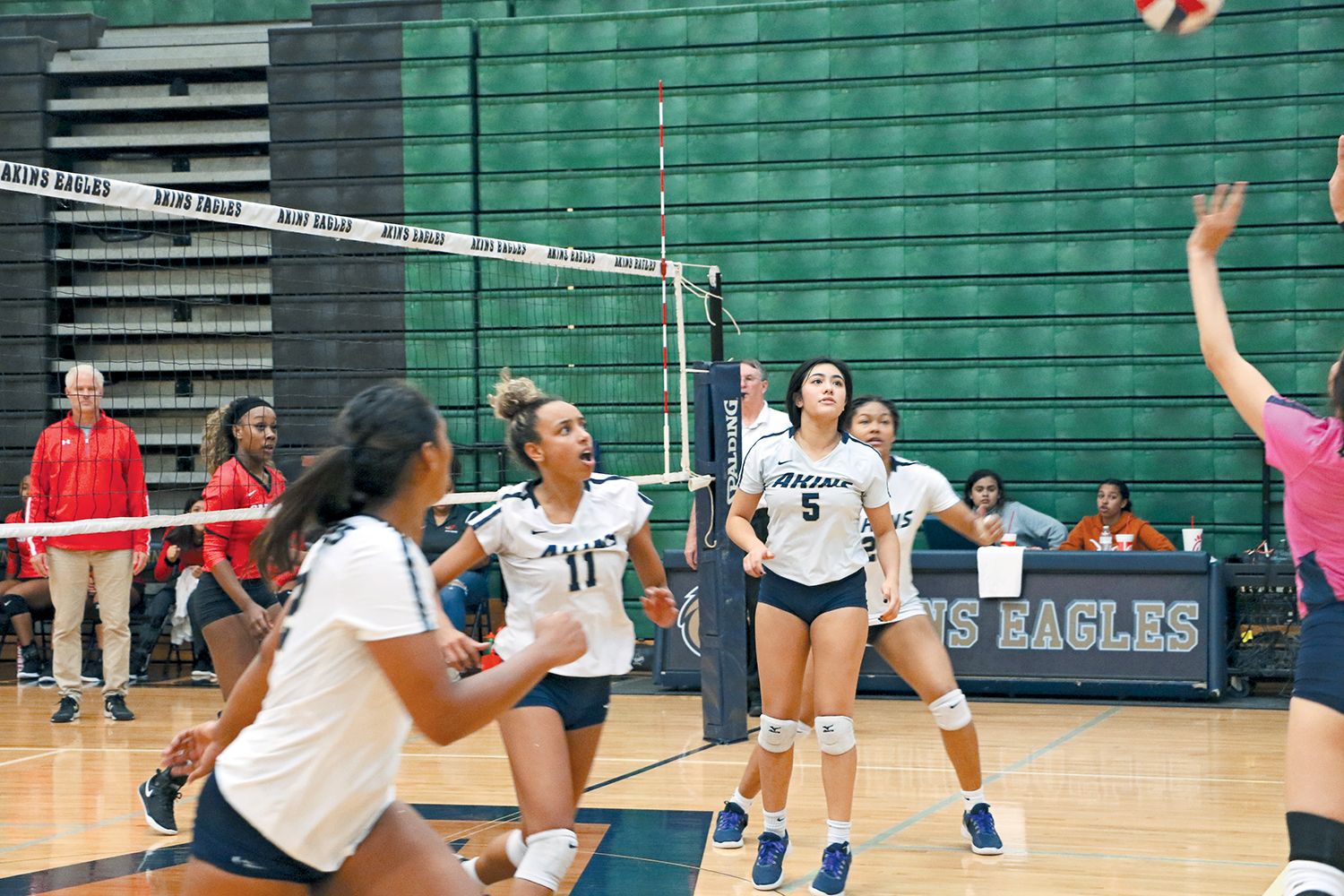 Seniors Zola Schemenauer-Moore (11) and Kayla Muñoz (5) move to play a ball in mid air. They played their final game as Eagles against Del Valle.
