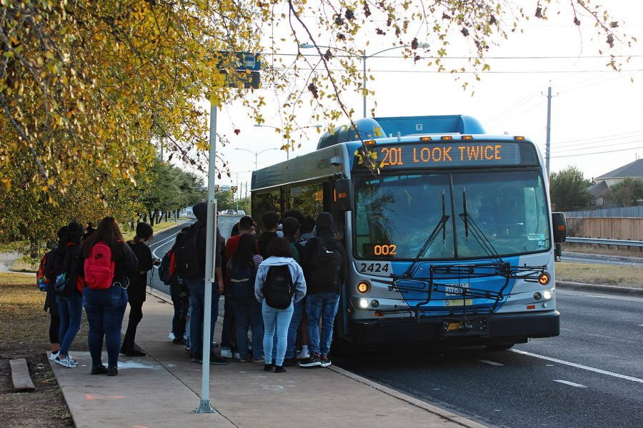 Akins+students+board+a+city+bus+after+school+at+the+bus+stop+on+First+Street.+Capital+Metro+bus+service+is+one+of+many+option+students+use+to+get+around+town+without+a+car.