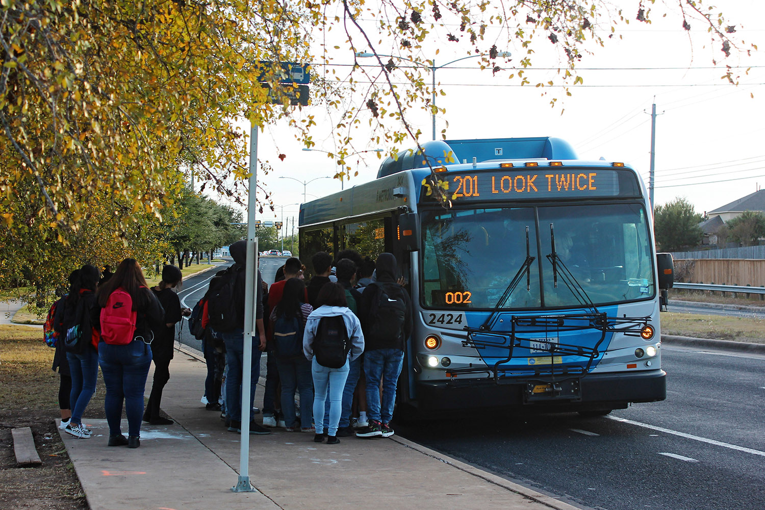 Akins students board a city bus after school at the bus stop on First Street. Capital Metro bus service is one of many option students use to get around town without a car.