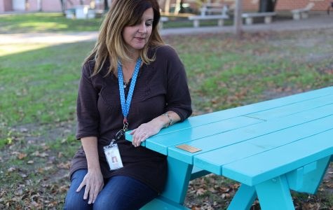 Picnic tables in courtyard purchased to honor student