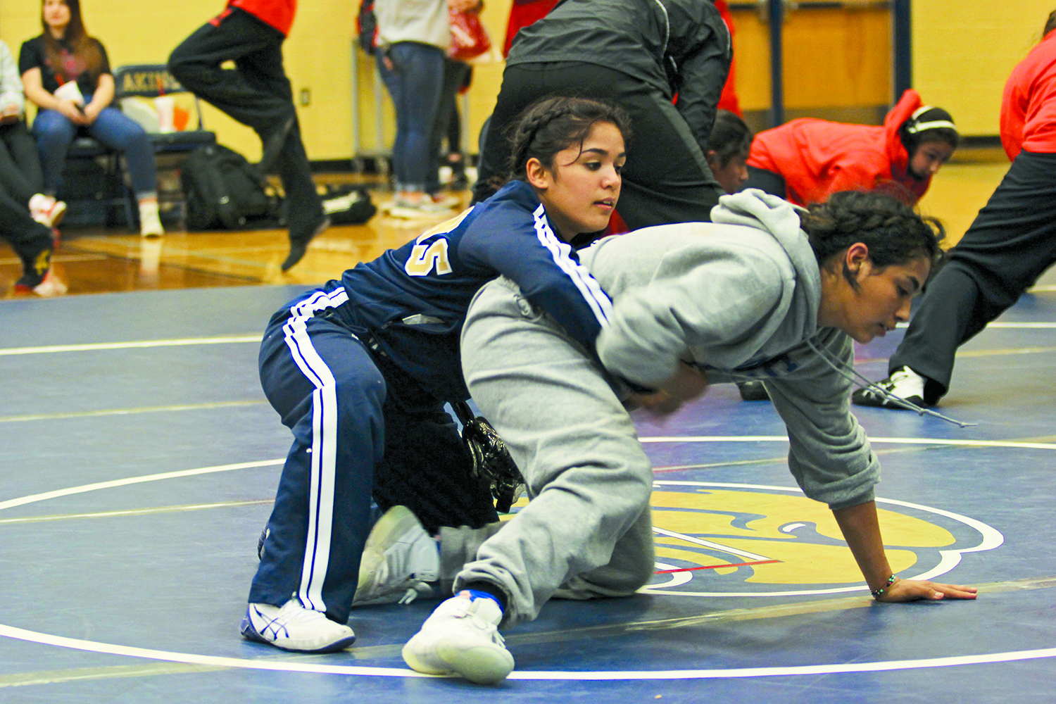 Akins wrestlers warm up before a match against New Braunfels Canyon High School. The wrestlers spent many hours a week in preparation before their season started in November.