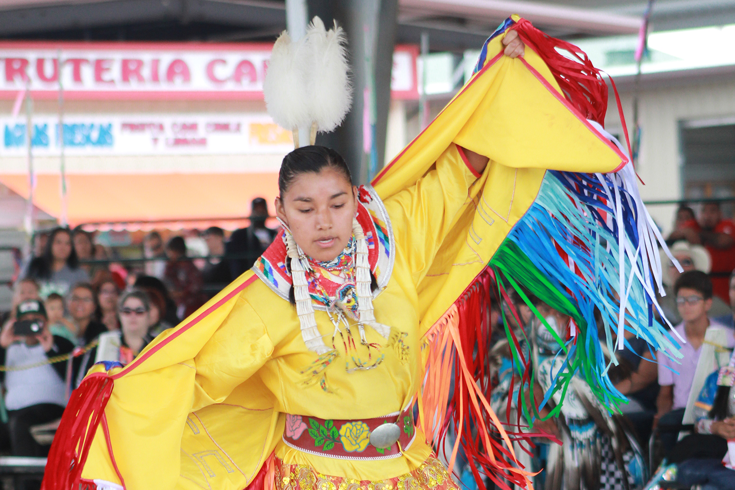 Fancy Dancer dancing to the beat of a Pow Wow drum during the celebration