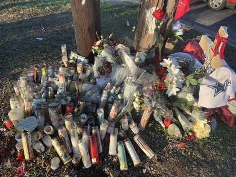 Candles are left at the site of the accident on Bluff Springs Rd.