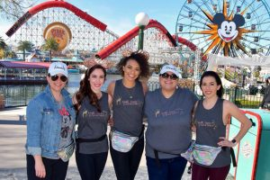 Diamond Dazzler dance instructor Ally Gates (right) poses for a shot with Akins staff on a student trip to Disneyland. Starting this fall, Jordyn Marsh (center) will take over as the new head dance director.
