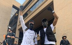 Anthony Evans (left) protests with his twin brother Arthur Evans (right) at the Austin Police Department on May 31 before he was shot with a rubber bullet in his face, causing a severe injury to his jaw.