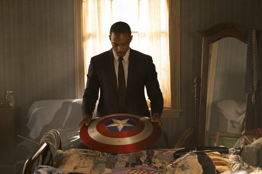 Sam Wilson is looking at the Captain America shield that was given to him by Steve Rogers at the end of Endgame. Sam will take the shield to the U.S. government to have it as a memorial.