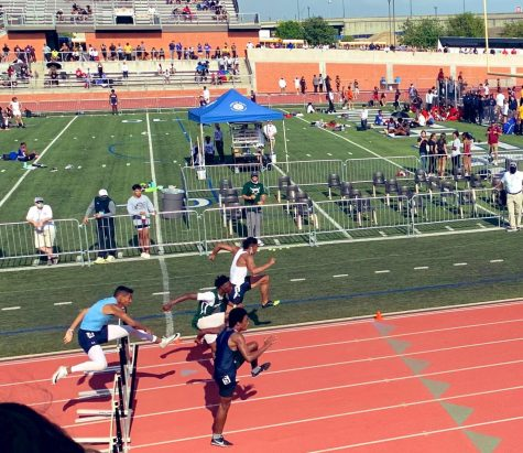 Engine on full throttle- Senior Trystin Brown (far end) hurdles over to state against competing runners.
