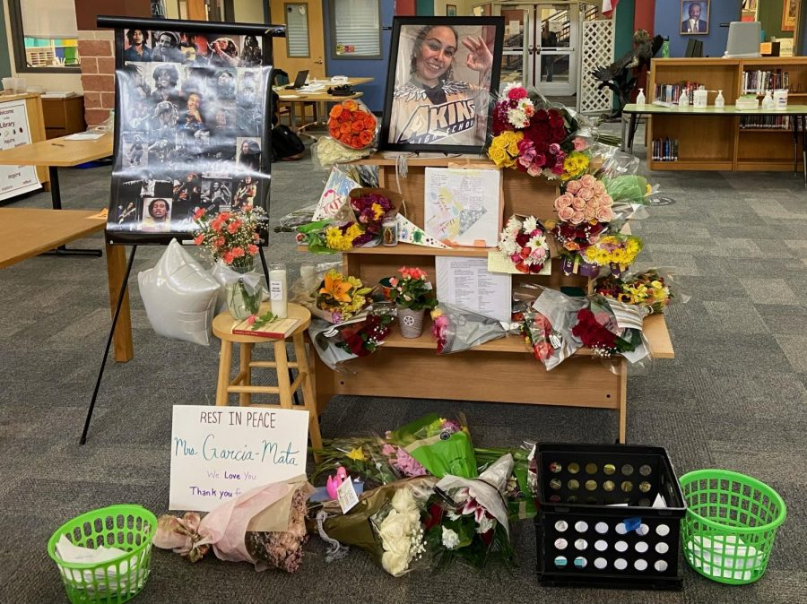 Students dropped off flowers and letters in remembrance of teacher Christina Garcia-Mata.