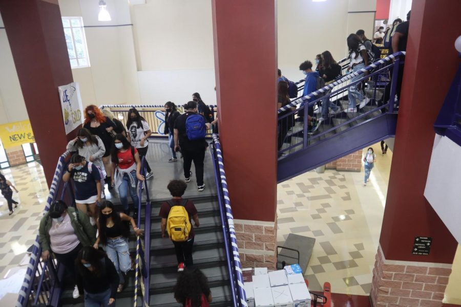 Students walking down the stairs on the first day of school.