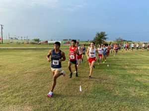 Jaedyn Pesina leads the pack at the Chaparral meet on August 27th.