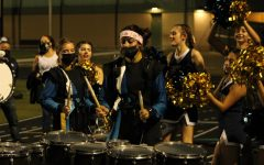 Akins Marching Band plays for the student section.